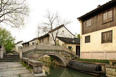 The view  in a Chinese traditional village. A good view in a Chinese  traditional village with small river and old stone bridge Stock Photography