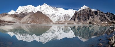 View of Cho Oyu mirroring in lake Stock Photography