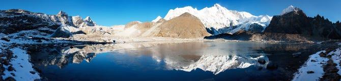 View of Cho Oyu mirroring in lake - Nepal Stock Photo