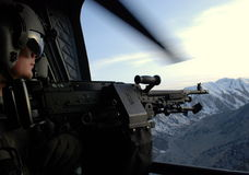 View from a chopper in Afghanistan. A soldier from US Army during a flight in Logar Province, Afghanistan, April 2009 Royalty Free Stock Photo