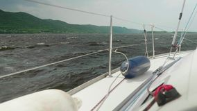 View of choppy water of reservoir from yacht cockpit. On summer day stock footage