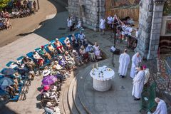 View on the Christian disabled pilgrims during the divine service in the Sanctuary of Our Lady of Lourdes. The Hautes-Pyrenees department in the Occitanie Royalty Free Stock Image