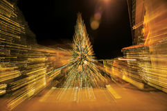 View of Christmas tree with lights forming an abstract effect in Penedo. Royalty Free Stock Photography