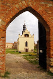 View of the church through the arch gate. View of the church of St. Michael through the arch gate  in Medzhybozh fortress Royalty Free Stock Image