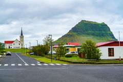 View of Church of Grundarfjordur Village. With the famous mount Kirkjufell in the north of the Snaefellsnes peninsula in the west of Iceland stock photography