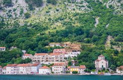 View on Church of Help of Christians and houses in Muo from Kotor, Montenengro. View on Church of Help of Christians and houses in Muo from Kotor Royalty Free Stock Images