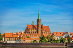 View of Church of Holy Cross and St. Bartholomew on Tumski Island Royalty Free Stock Photography