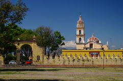 View of the church in Mexico. View of the church with yellow fence on the background of the volcano, Mexico Stock Photography