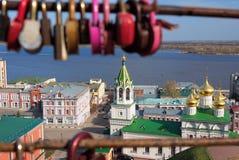 View of Church of the Nativity of John the Precursor through the bridge with love locks. In Nizhny Novgorod. Russia Stock Photography