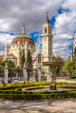 View at the church San Benito and San Manuel from Retiro park in Madrid royalty free stock photo