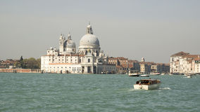 View of the Church of Santa Maria della Salute from the boat. Ve Royalty Free Stock Photo