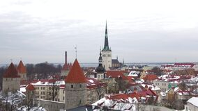 View of the church spire of Saint Olaf, gloomy March day. Tallinn, Estonia. View of the church spire of Saint Olaf, gloomy March day. Tallinn. Estonia stock video