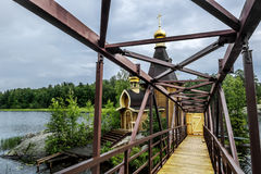 View of the Church of St. Andrew on the island on the lake Vuoks. Karelia.Russia.15 Aug 2016 .View of the Church of St. Andrew on the island on the lake Vuoksa Stock Photography