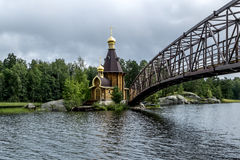 View of the Church of St. Andrew on the island on the lake Vuoks. Karelia.Russia.15 Aug 2016 .View of the Church of St. Andrew on the island on the lake Vuoksa Stock Photos