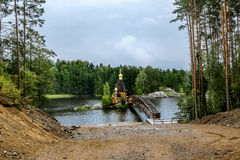 View of the Church of St. Andrew on the island on the lake Vuoks. Karelia.Russia.15 Aug 2016 .View of the Church of St. Andrew on the island on the lake Vuoksa Stock Images