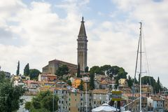 Church st euphemia in rovinij , Croatia. View of the  church st euphemia , and some colorful houses in the little town ot rovinj in Croatia Royalty Free Stock Photo