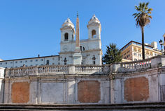 View of the church of Trinita dei Monti and the obelisk in front of her, Rome, Italy Stock Photos