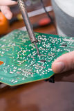 View of a circuit board being repaired. Stock Image