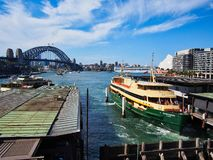 Cruise Ship Leaving Circular Quay, Australia. View of Circular Quay, Sydney harbour, with the Harbour Bridge, Opera House, harbour ferries and a large white stock image
