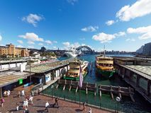 Circular Quay Ferries and the Sydney harbour Bridge, Australia. View of Circular Quay, Sydney harbour, with the Sydney Harbour Bridge, harbour ferries and a stock photography