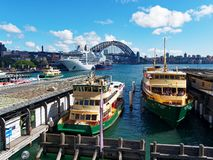 Circular Quay Ferries and the Sydney harbour Bridge, Australia. View of Circular Quay, Sydney harbour, with the Sydney Harbour Bridge, harbour ferries and a royalty free stock photo