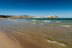 View of the citadel and port of Calvi from across Calvi bay. View of the citadel, town and port of Calvi looking across Calvi bay with the beach in the Stock Photo