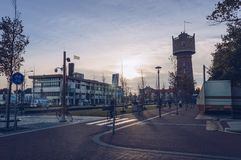 View of citizen of Den Helder riding bicycles in the eveneing with Water tower. Den Helder, The Netherlands, October 13, 2018: view of citizen of Den Helder royalty free stock photos