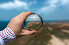 A view of the city of Anapa through the prism in his hand. Stock Image