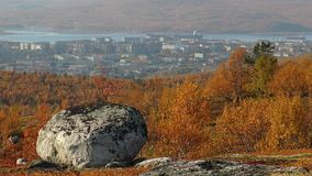 View of the city and the bay with bright red autumn hills. stock video footage