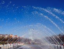 View of the city through the fountain. View of the city and blue sky through the fountain stock photo