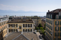 View with city center, lake and mountains. View of Geneva lake and mountains from Lausanne city center. Switzerland Royalty Free Stock Photography