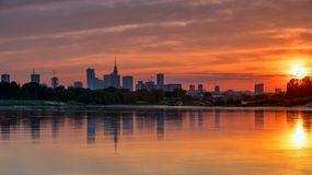 View of the city center from the river at sunset Stock Image