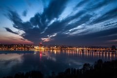 View of the city of the Dnieper Dnepropetrovsk. Autumn, the lights are reflected in the water, Ukraine stock photo