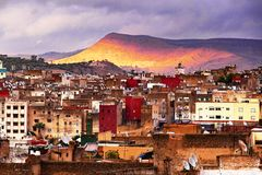 Sunset view on the historic part of the city of Fes in front of red mountains, Morocco, Africa stock photos