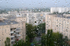 View of the city  through the glass with raindrops Stock Photo