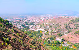 View of the city of Granada. From the mountains on a sunny day, at the bottom valleys look Stock Photos