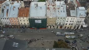 View from City Hall at peaceful movement of trams through narrow streets of Lviv. Stock footage stock footage