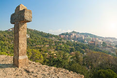 View of city from hill with big stone cross Stock Photos