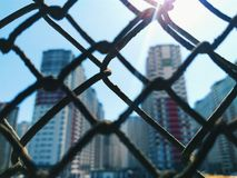 A view of the city houses behind the mesh fence Royalty Free Stock Photography