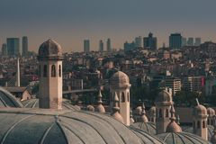 View of city Istanbul, Bosphorus bridge from Galata tower. Outer view of dome in Ottoman architecture. Suleymaniye Mosque. Turkey royalty free stock photos