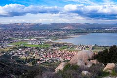 View on the city of Lake Elsinore, Southern California USA. Residential houses in a valley by the lake with mountains on the background. Panoramic view on the royalty free stock photography