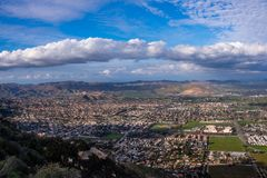 View on the city of Lake Elsinore, Southern California USA. Residential houses in a valley by the lake with mountains on the background. Panoramic view on the royalty free stock photo