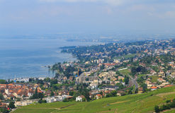 View on city of Lausanne. Switzerland, Lavaux village, vineyard, view on Lausanne city in background and beautiful blue Leman lake Royalty Free Stock Photography