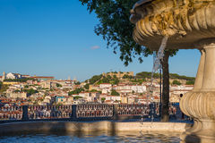 View of the city Lisbon downtown during sunset with sao jorge ca Royalty Free Stock Image