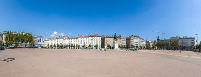 View of the city of Lyon at Place Bellecour, France. LYON, FRANCE - AUG 31, 2016: view of the city of Lyon at Place Bellecour, France under blue sky with statue Royalty Free Stock Images