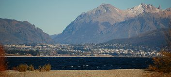 View of city and mountains. View of distant city, mountains in the background and lake in the foreground Royalty Free Stock Photo