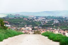 the view of the city from the mountains, the Italian house at the foot of the mountains, town between mountains, panoramic landsca royalty free stock photos