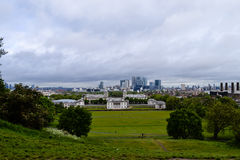 View of city near Greenwich with beautiful green grass and clouds landscape Stock Photos