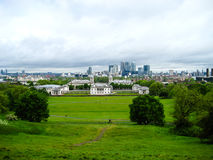 View of city near Greenwich with beautiful green grass and clouds landscape Royalty Free Stock Photo