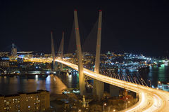 View the city at night, the bridge across the Bay at night, full of bright lights. Royalty Free Stock Photo